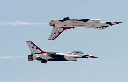Two U.S. Air Force Thunderbirds fly a back to back during a maneuver at the 42nd Naval Base Ventura County Air Show at Point Mugu, Sunday, April 1, 2007, near Ventura, Calif. (AP Photo/Richard Vogel)